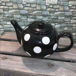 Black teapot with white polka dots